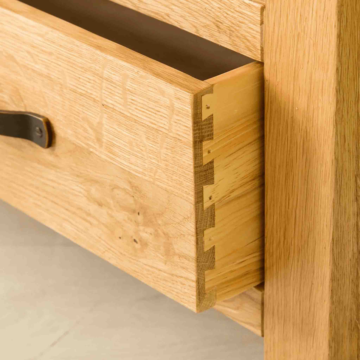 Drawer joint view of The Abbey Waxed Oak Corner TV Stand by Roseland Furniture