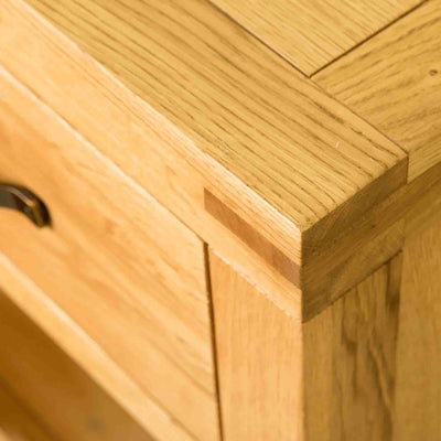 Top right corner view of The Abbey Waxed Oak Large Sideboard 3 Door Cabinet