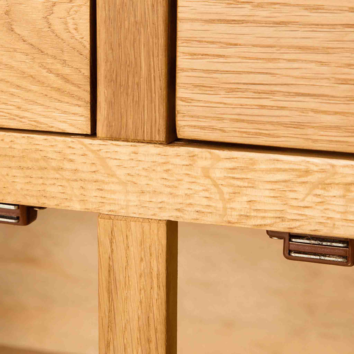 Close up of upper cupboard door catches on The Abbey Waxed Oak Large Sideboard 3 Door Cabinet
