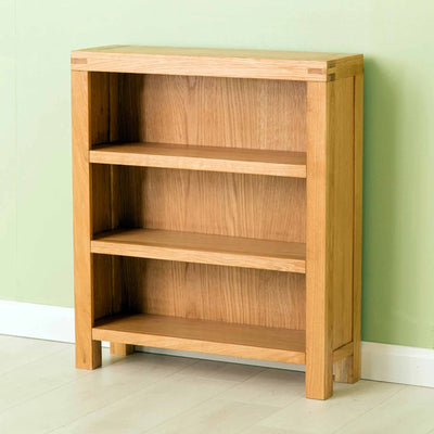 The Abbey Waxed Small Low Oak Bookcase with 3 Shelves from Roseland Furniture
