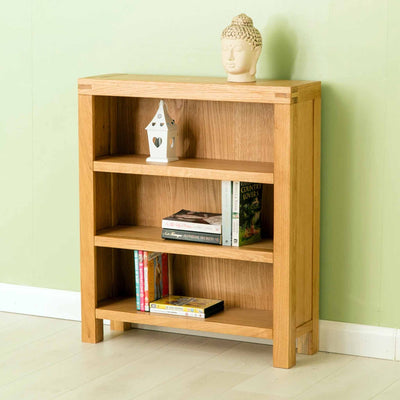 Angled object display view The Abbey Waxed Small Low Oak Bookcase from Roseland Furniture