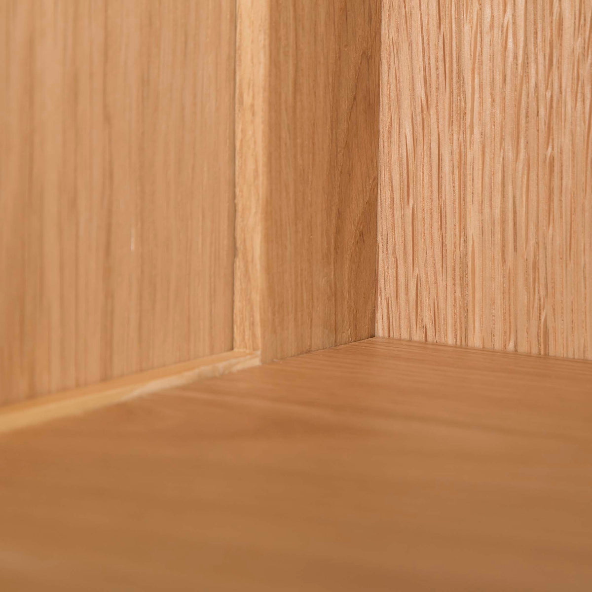 Abbey Waxed Small Low Oak Bookcase - Close up of corner at back of shelf