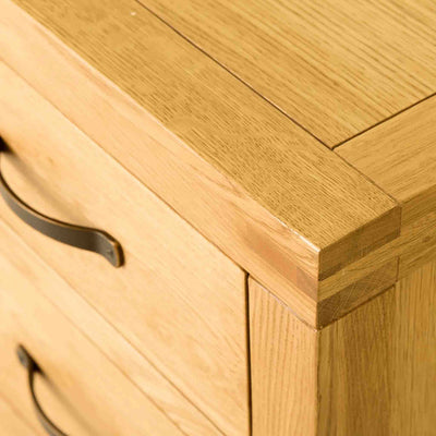 Close up of the top surface on The Abbey Waxed Oak Bedroom Chest of Drawers