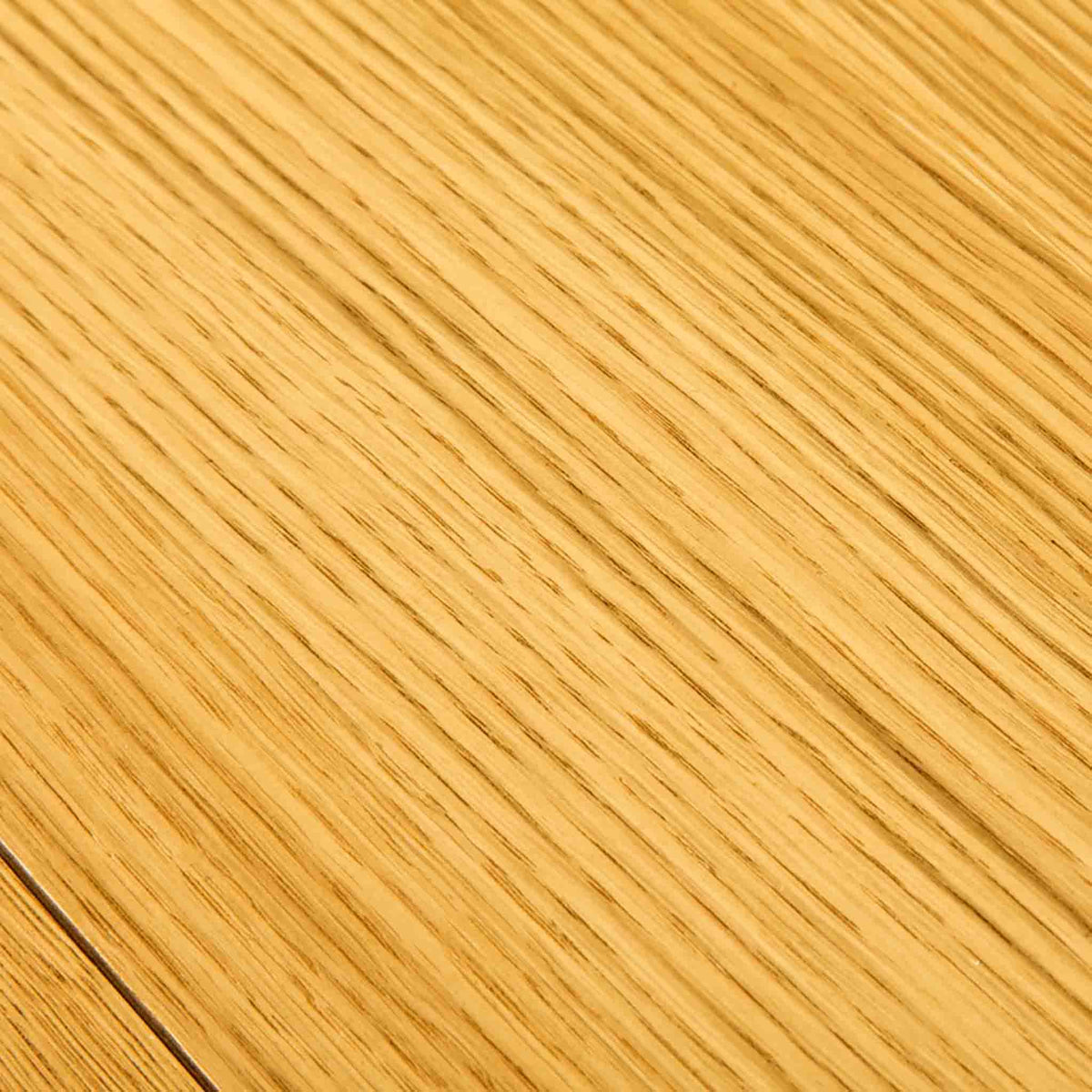 Close up of wood grain on The Abbey Waxed Oak Bedroom Chest of Drawers