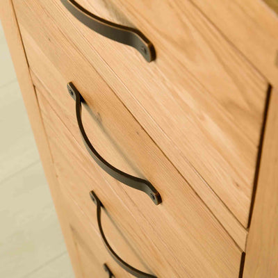 Closed drawers on The Abbey Waxed Oak Tallboy Chest of Bedroom Drawers