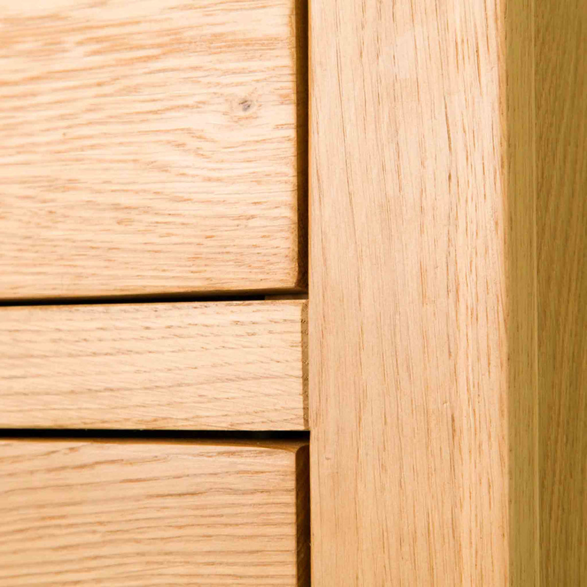 Side edge of The Abbey Waxed Oak Tallboy Chest of Bedroom Drawers