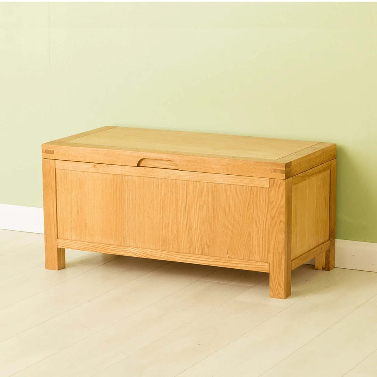 Side angle of The Abbey Waxed Oak Ottoman Blanket Box