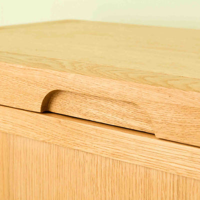 Lid handle on The Abbey Waxed Oak Ottoman Blanket Box