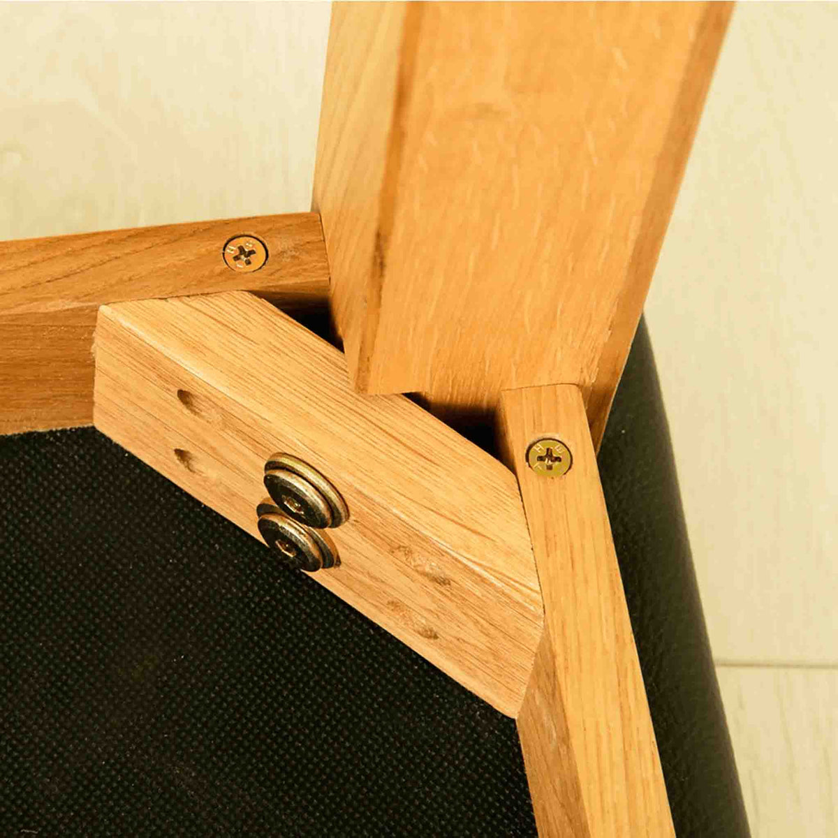 Close up of stool leg joint on The Abbey Waxed Oak Wooden Dressing Table Set
