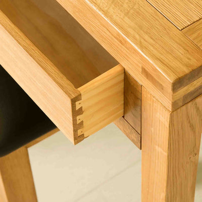 Open drawer view of The Abbey Waxed Oak Wooden Dressing Table