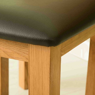 Close up of stool of The Abbey Waxed Oak Wooden Dressing Table Set