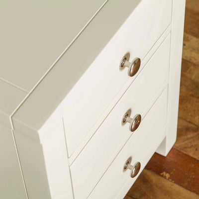 Close up of table edge on The Cornish White Wooden 3 Drawer Bedside Table