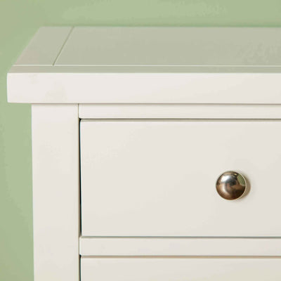 Close up of corner of The Cornish White Wooden 3 Drawer Bedside Table