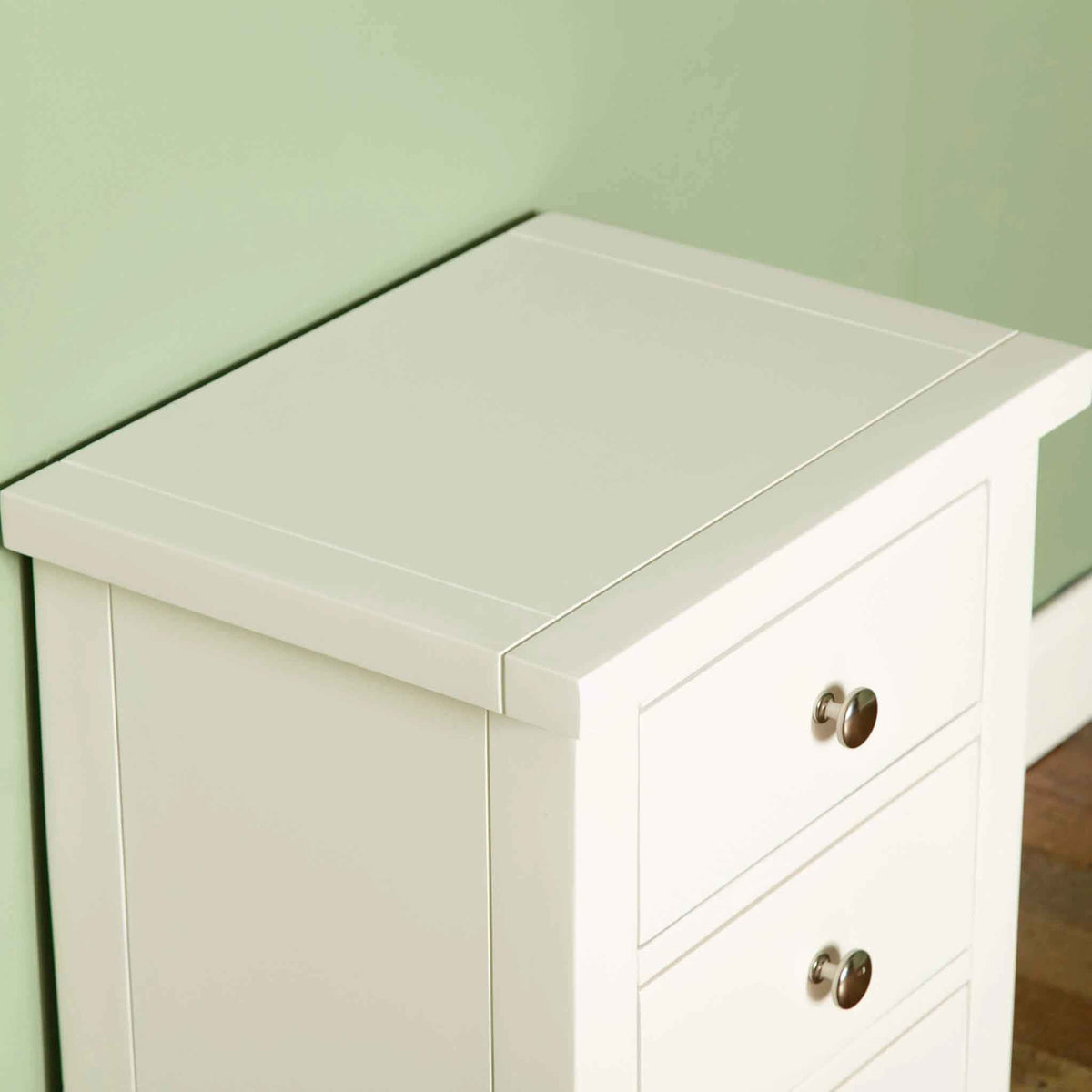 Tabletop view of The Cornish White Wooden 3 Drawer Bedside Table