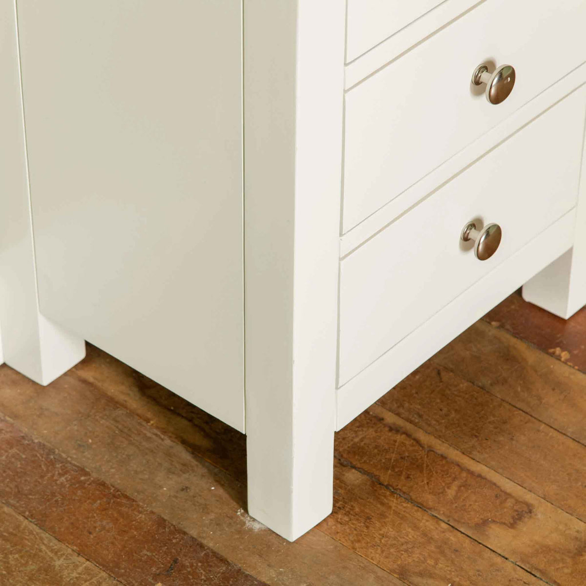 Close up of leg of The Cornish White Wooden 3 Drawer Bedside Table