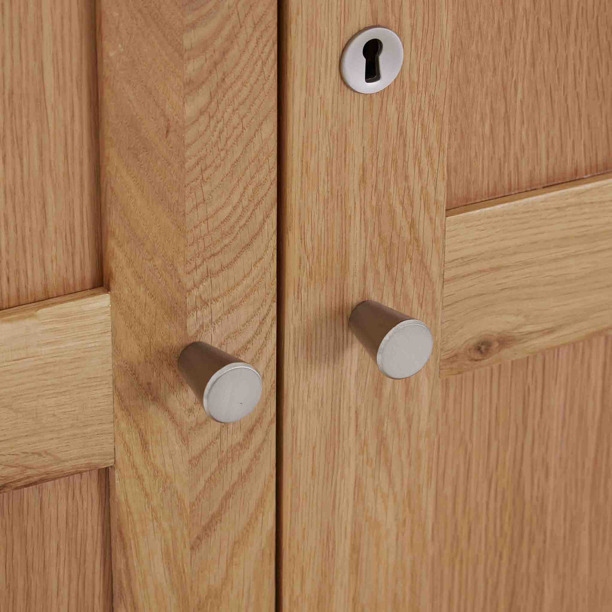 Falmouth Oak Double Wardrobe Close up of the chrome metal handles and door lock