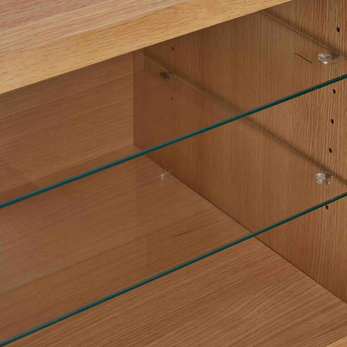 Close up of central glass shelves on the Side view of the Falmouth Oak Large TV Unit with 4 Drawers