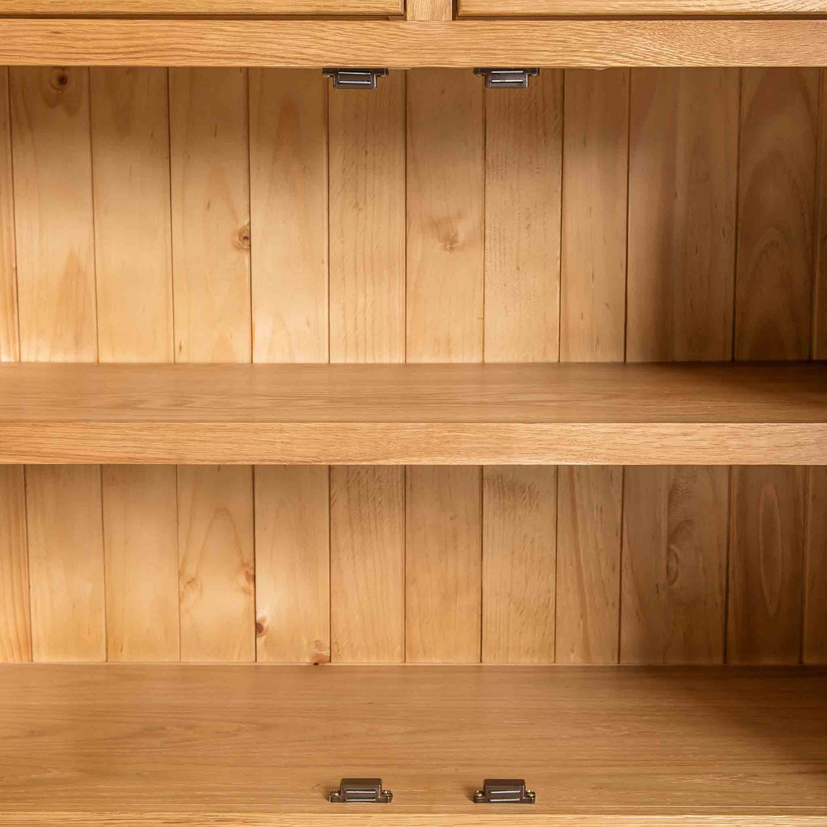 close up of cupboard with fixed shelf on the Roseland Oak 3 Door Sideboard