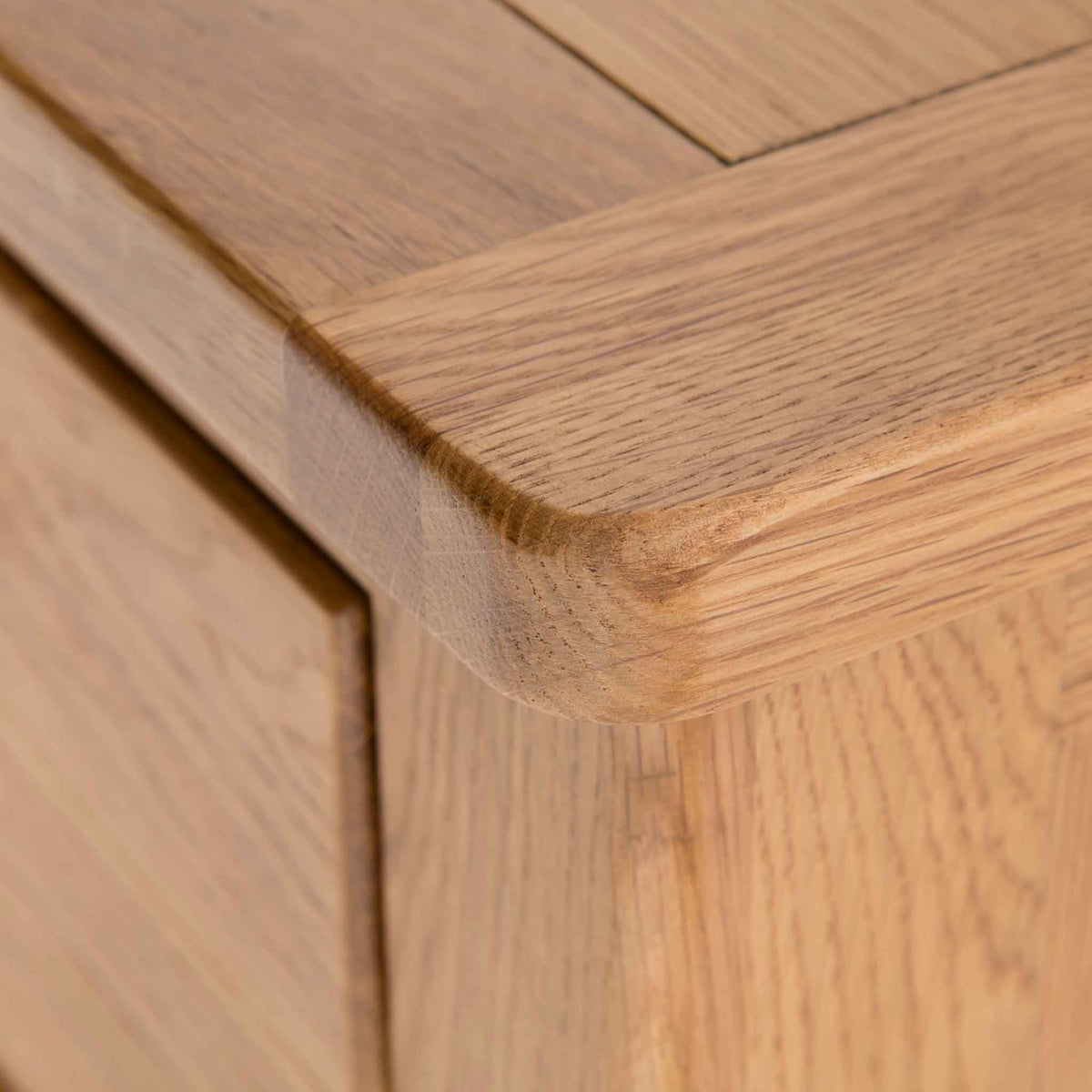 close up of round oak corners on the Roseland Oak 3 Door Sideboard
