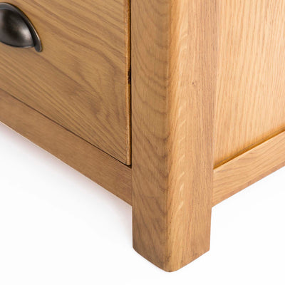 Roseland Oak 2 Over 2 Drawer Chest of Drawers - Close up of foot of chest