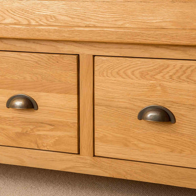 Drawer handles of Roseland Oak Triple Wardrobe & Drawers