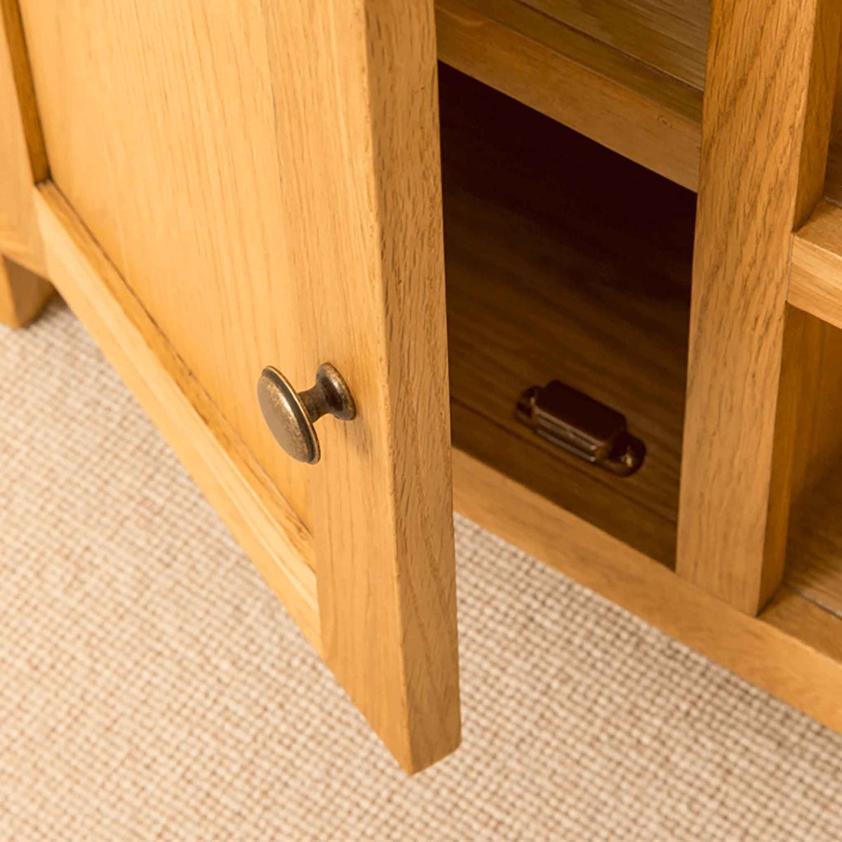 Cupboard open of Roseland Oak 100cm TV Stand