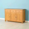 Nordic Oak 3 Door 3 Drawer Sideboard by Roseland Furniture