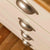 Close up of drawers on  The Padstow Cream Wooden Chest of Drawers