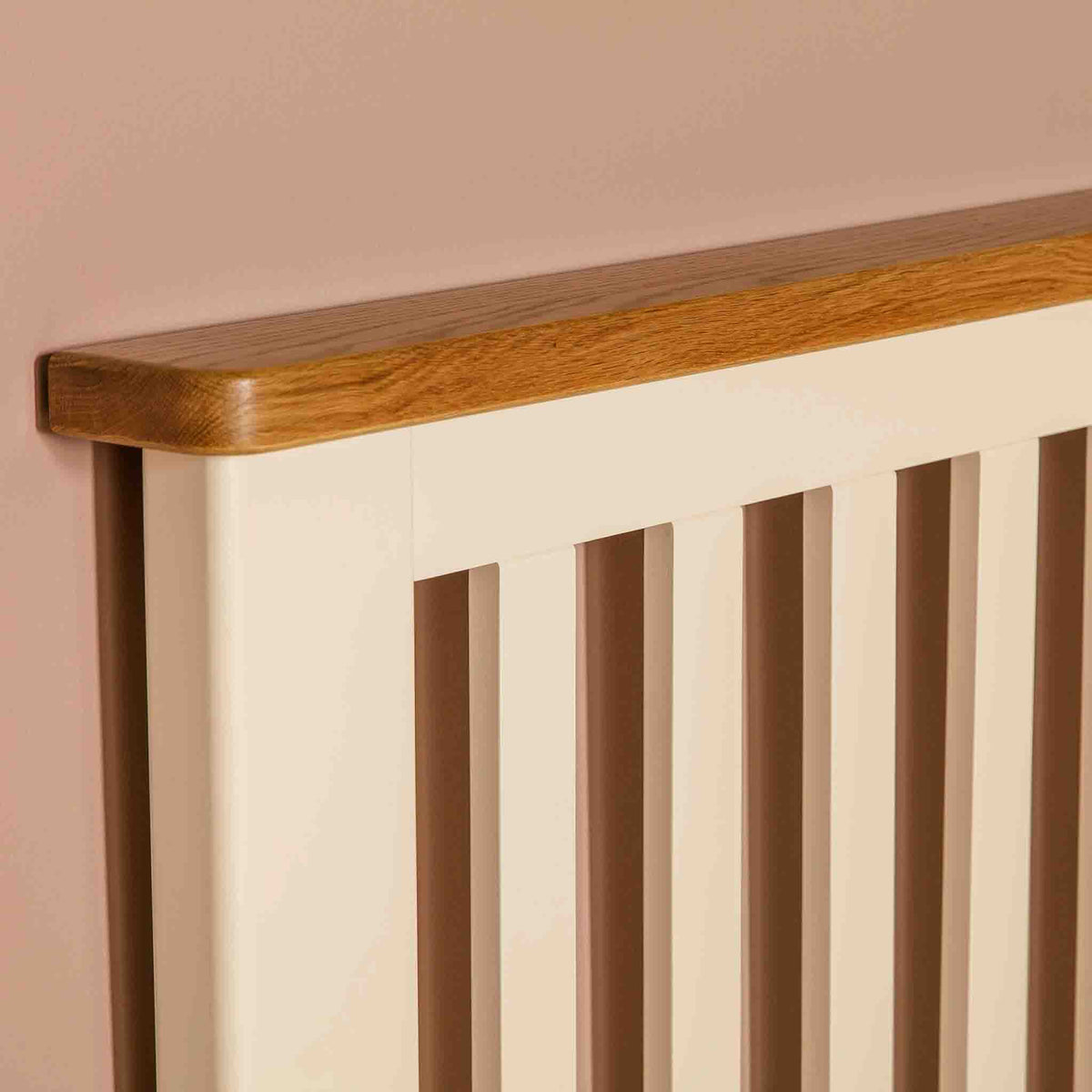 Close up of oak headboard beam on The Padstow Cream 3 ft Wooden Single Bed Frame