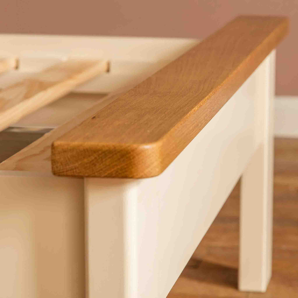 Close up of oak foot beam on The Padstow Cream 3 ft Wooden Single Bed Frame