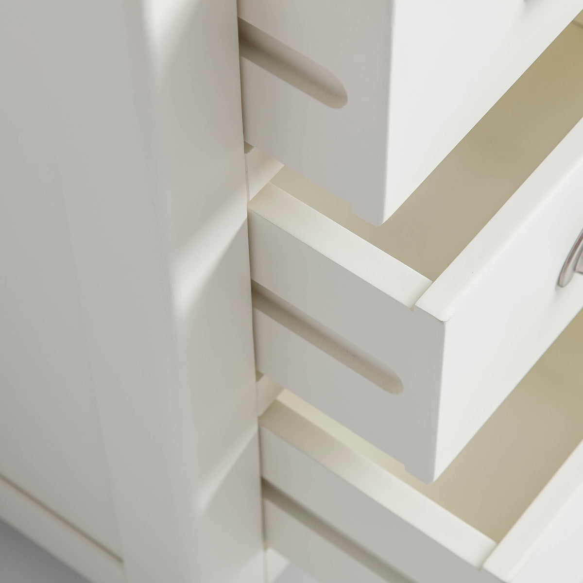 close up of drawer runners on The Padstow White Wooden Bedside Table with 3 Drawers