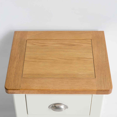 view of oak top surface on the The Padstow White Wooden Bedside Table with 3 Drawers