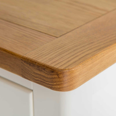 close up of the oak top rounded corner on The Padstow White Wooden Bedside Table with 3 Drawers