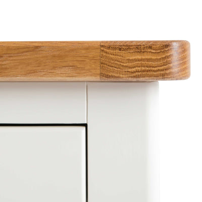 Close up oak top edge on The Padstow White Wooden Bedside Table with 3 Drawers