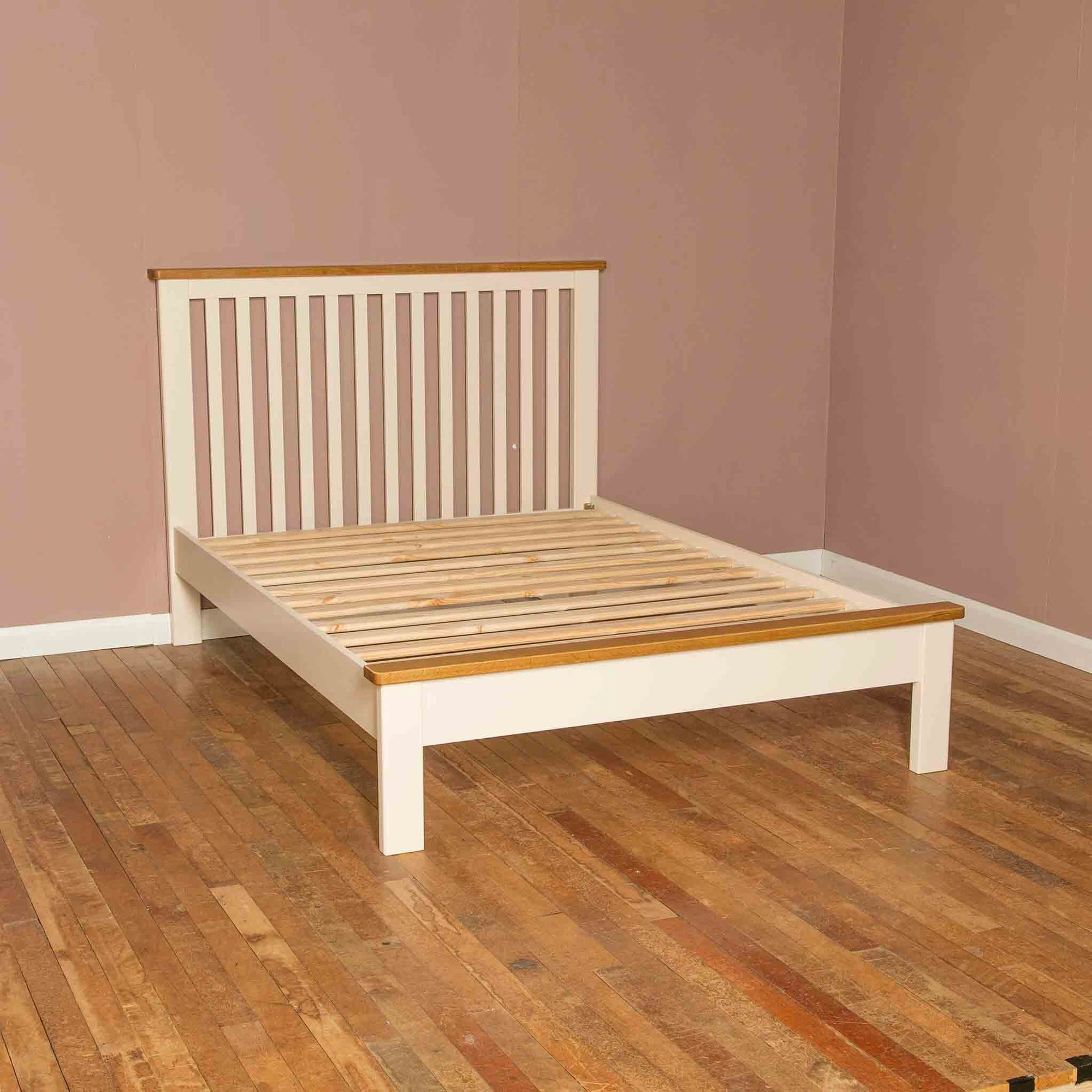 Side view of the The Padstow Cream 5 ft Solid Wood King Size Bed Frame with Oak