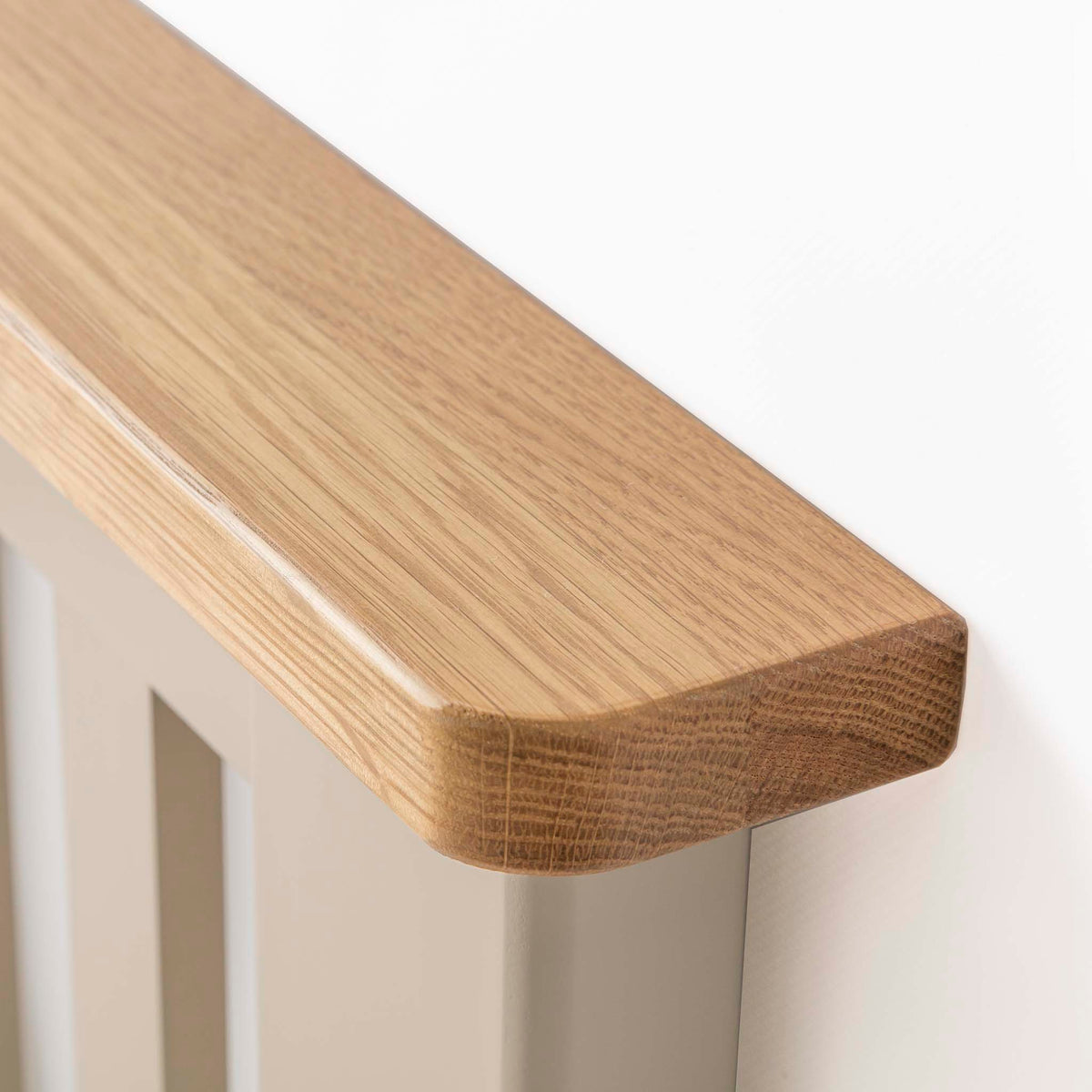 Padstow Stone Grey Double Bed Frame - Close up of Oak top of Header
