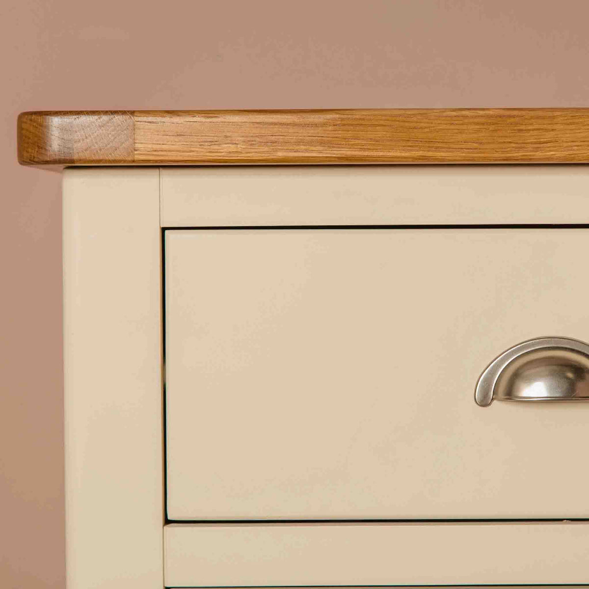 Close up of the oak top edge on The Padstow Cream Wooden Tallboy Chest of Drawers