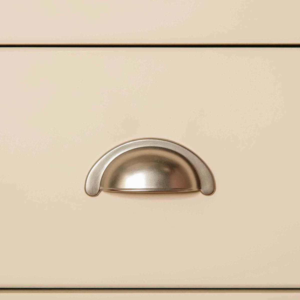Close up of metal handle on The Padstow Cream Wooden Tallboy Chest of Drawers