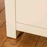 Close up of leg on The Padstow Cream Wooden Tallboy Chest of Drawers