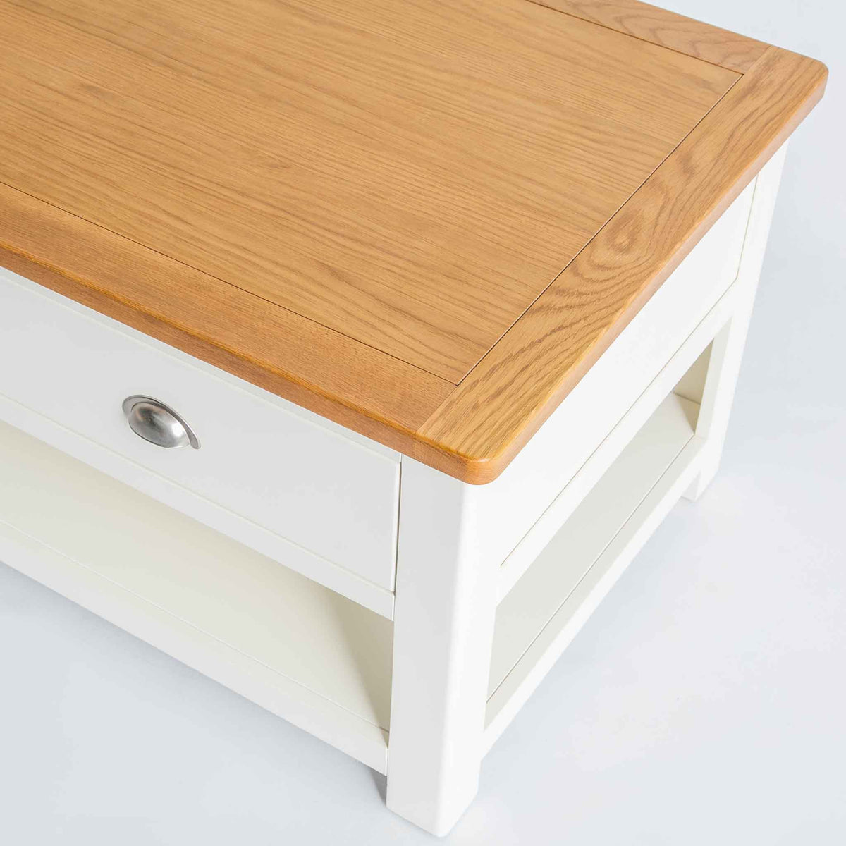 close up of the oak top on The Padstow White Solid Wood Coffee Table