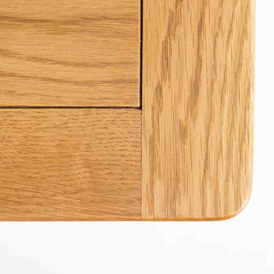 Close up of oak top rounded corner on The Padstow White Solid Wood Coffee Table