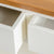 Close up of painted wooden drawers on The Padstow White Solid Wood Coffee Table