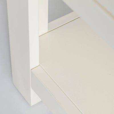 Close up of lower shelf on The Padstow White Solid Wood Coffee Table
