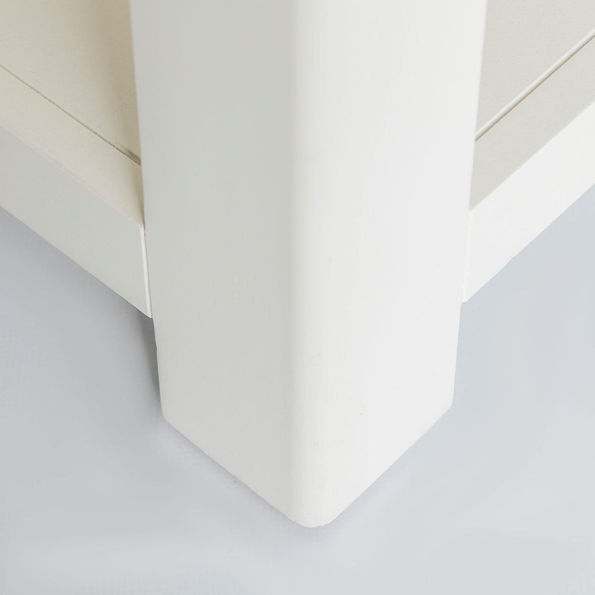 Close up of the solid wood legs on the The Padstow White Solid Wood Coffee Table