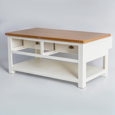 side view of The Padstow White Solid Wood Coffee Table with reversible drawers