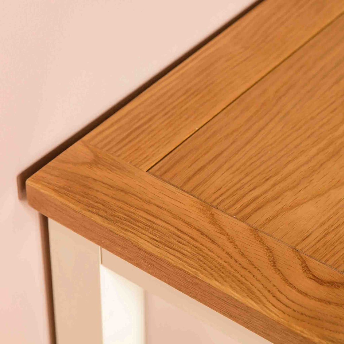 Close up of tabletop corner on The Padstow Cream Small Wooden Dressing Table