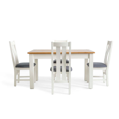 Padstow White Wooden Extending Dining Table - Image of table with chairs when closed