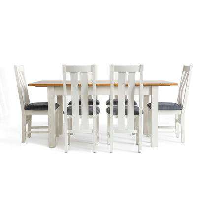 Padstow White Wooden Extending Dining Table - Image of table with six chairs when fully extended