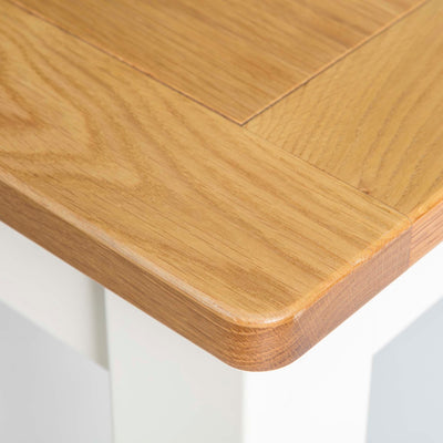 Padstow White Wooden Extending Dining Table - Close up of corner of table Top