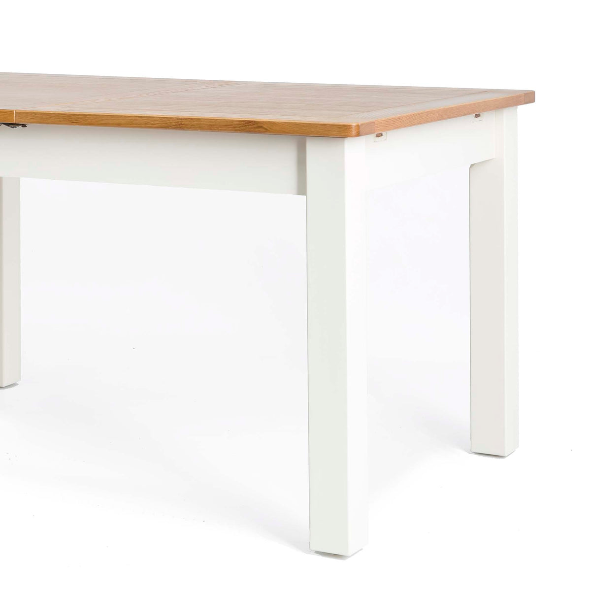 Padstow White Wooden Extending Dining Table - Close up of table top and legs